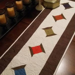 "BLD-010 – ""DANCING SPOOLS"" Table Runner"